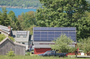Solar PV and thermal panels on the barn and home roofs.